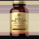 An amber glass bottle of Solgar's Ester-C Plus 500mg Vitamin C Vegetable Capsules on a white backdrop.